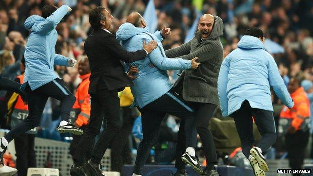Pep Guardiola and the Manchester City coaching staff celebrate