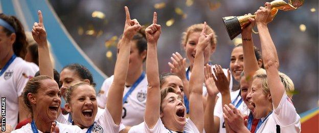 Megan Rapinoe lifts the trophy