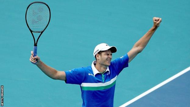 Poland's Hubert Hurkacz holds his arms aloft in celebration after beating Jannik Sinner to win the 2021 Miami Open men's singles title