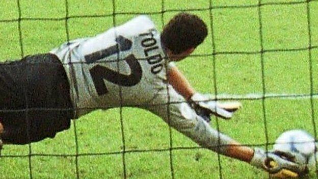 Italy's Toldo saves a penalty