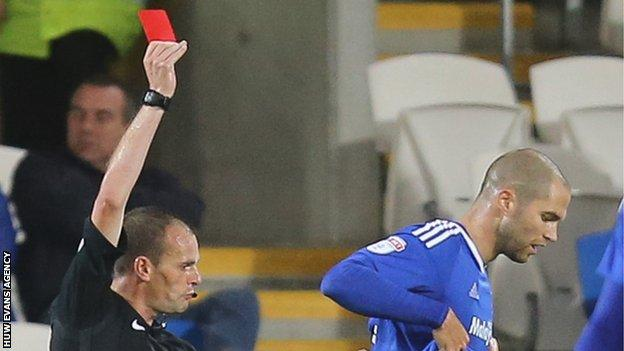 Matthew Connolly of Cardiff City is shown a red card