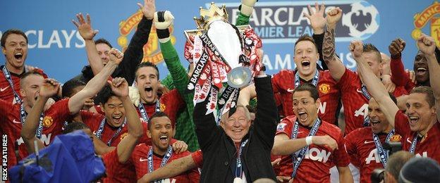 Sir Alex Ferguson (centre) holds aloft the Premier League trophy