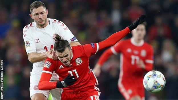 Gareth Bale of Wales is tackled by Henrik Dalsgaard