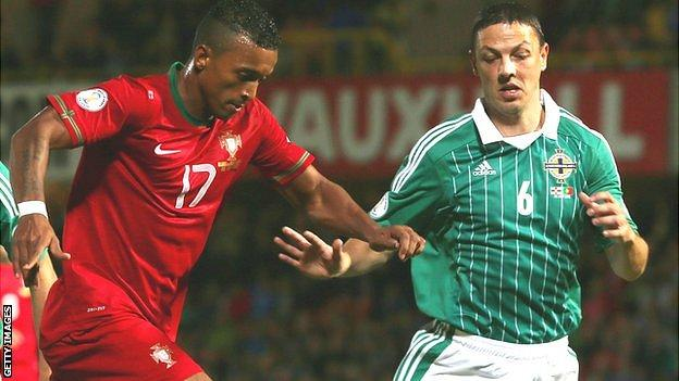 Chris Baird (right) in action against Nani of Portugal