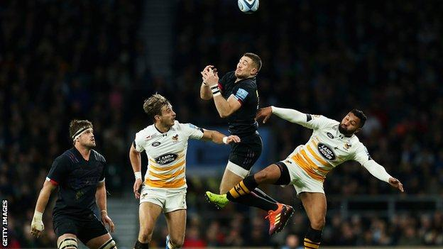 Harlequins' Mike Brown goes up for a high ball against Wasps