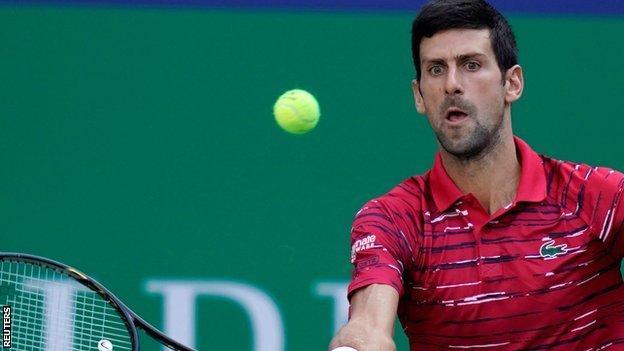 Novak Djokovic eased past John Isner at the Shanghai Masters