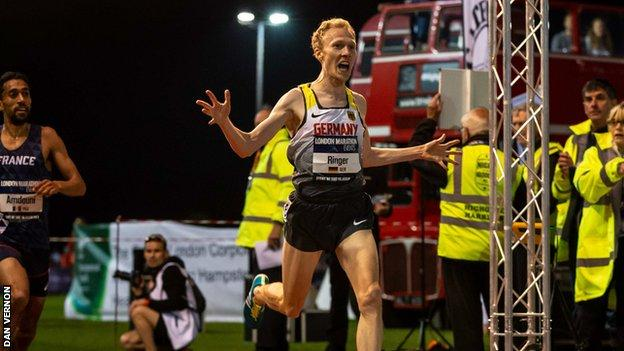 Germany's Richard Ringer celebrates as he crosses the finish line first in the Night of the 10,000m PB's in 2018