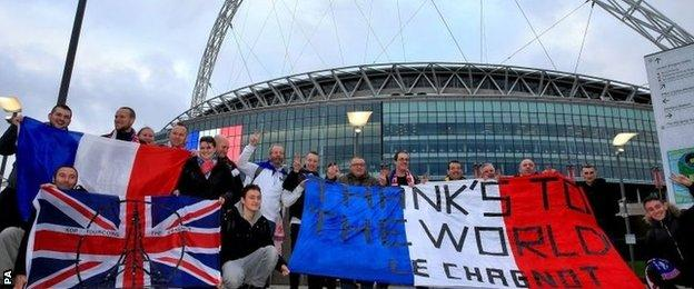 Fans arrive early at Wembley Stadium before the friendly game