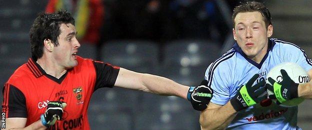 Kevin McKernan battles with Dublin's Paul Flynn in the 2011 Football League game