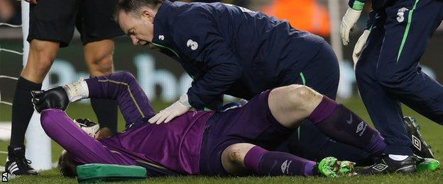 Rob Elliot was carried off with a bad-looking knee injury in the first half