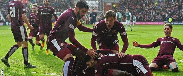 Hearts' Arnauld Djoum is surrounded by teammates after scoring his side's opener