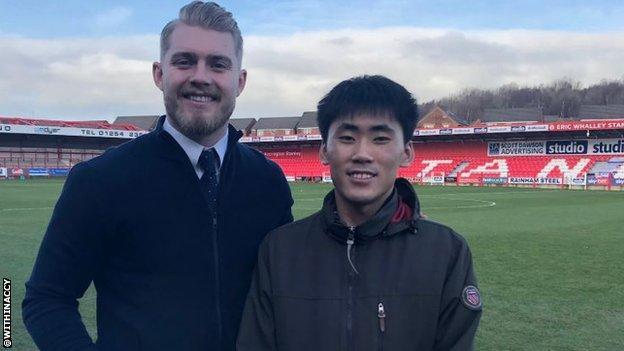 Accrington goalkeeper Connor Ripley with Korean fan Jung Min Yoo