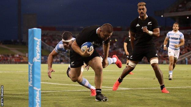 Dane Coles scores a try in the first half for New Zealand
