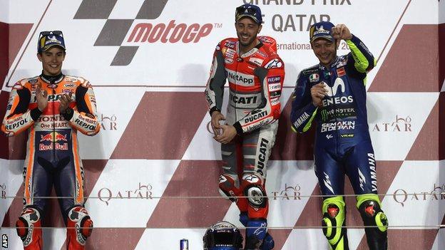 "Repsol Honda Team""s Spanish rider Marc Marquez (L, 2nd place), Ducati Team""s Italian rider Andrea Dovizioso (C, 1st place) and Movistar Yamaha MotoGP""s Italian rider Valentino Rossi (R, 3rd place"