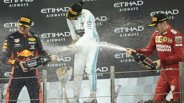 Max Verstappen, Lewis Hamilton and Charles Leclerc on the podium after the 2019 Abu Dhabi Grand Prix