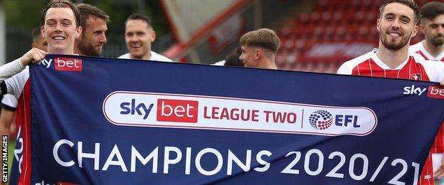 Cheltenham players celebrate winning League Two