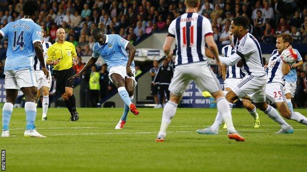 Manchester City midfielder Yaya Toure scores against West Brom