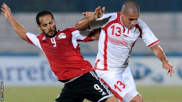 Egyptian forward Walid Sliman in action against Tunisia