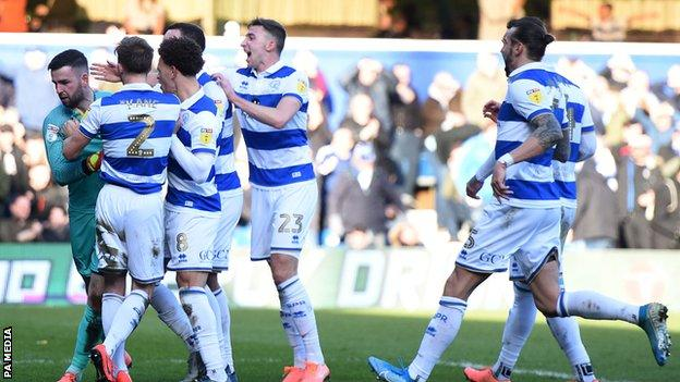 QPR players celebrate Liam Kelly's penalty save