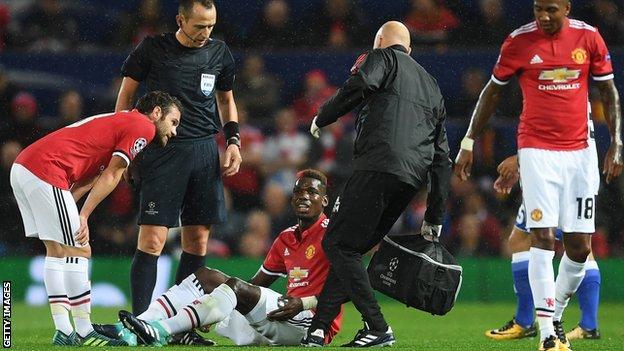 Paul Pogba receives treatment