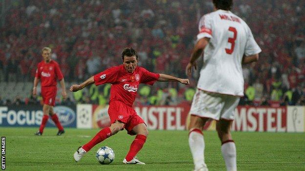 Substitute Vladimir Smicer lets fly home from the edge of the area. Milan keeper Dida gets a hand to his shot but cannot keep it out