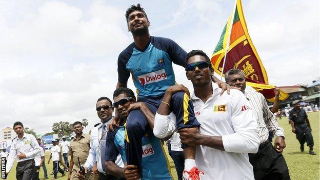 Sri Lanka's Kumar Sangakkara is carried on his team-mates' shoulders after his final Test