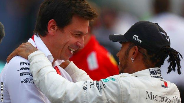 Toto Wolff and Lewis Hamilton embrace