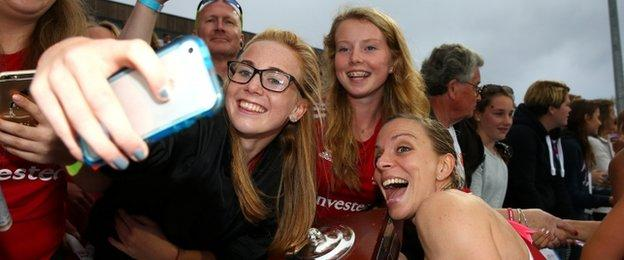 England skipper Kate Richardson-Walsh celebrates with fans after the victory