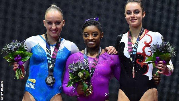 Silver medallist, Netherlands' Sanne Wevers, gold medallist Simone Biles and bronze medallist Pauline Schaefer, of Germany