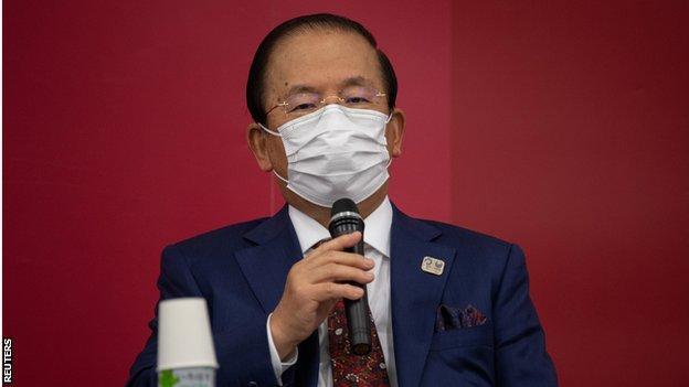Tokyo 2020 chief executive Toshiro Muto speaks to the media