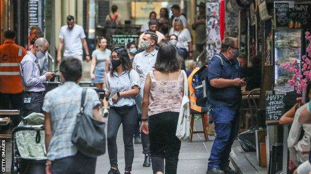 People walk around the shops and cafes in Melbourne's Central Business District