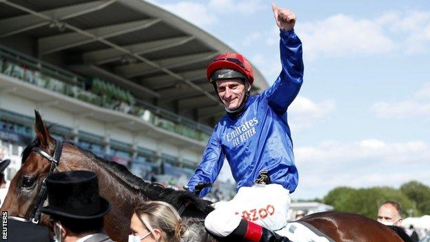 Adam Kirby celebrates after winning the Derby with Adayar