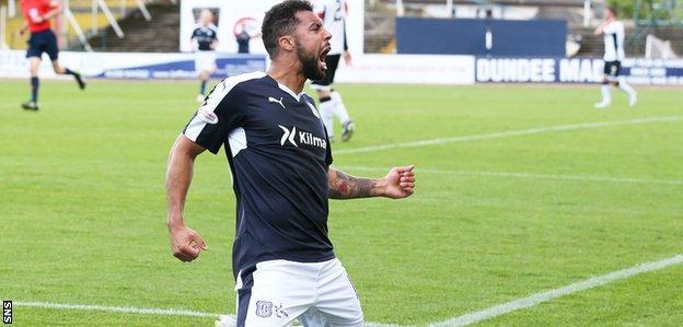 Dundee striker Kane Hemmings celebrates