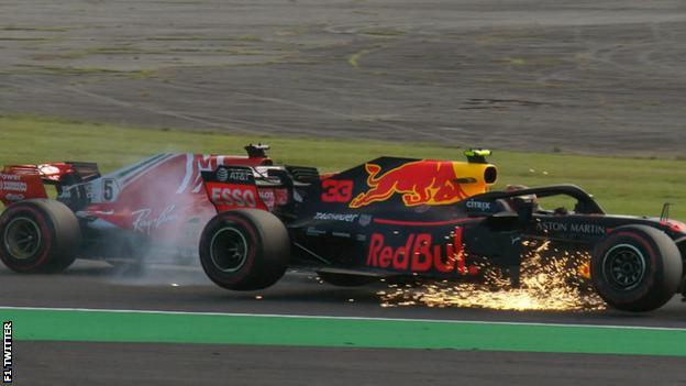 Sebastian Vettel collides with Max Verstappen
