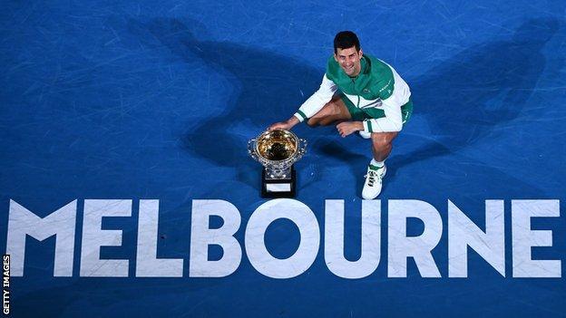 Novak Djokovic with the Australian Open trophy
