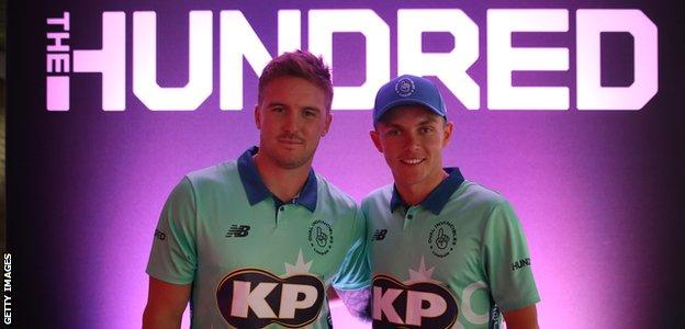 England's Jason Roy and Sam Curran pose in Oval Invincibles shirts