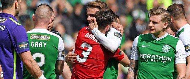 Graeme and Andrew Shinnie embrace