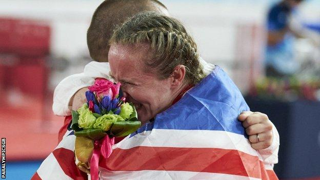 Neil and Lora Fachie embrace after their medal ceremonies