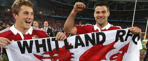 Jonathan Davies and Mike Phillips fly Whitland RFC's Welsh flag as they celebrate the 2013 Lions tour win in Australia