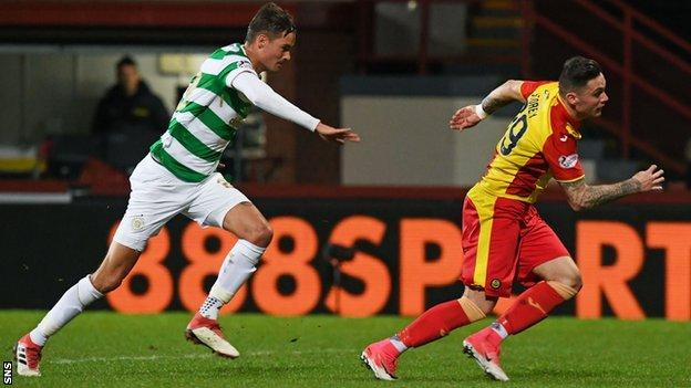 Partick's Miles Storey stumbles in the box after being tugged back by Celtic's Mikael Lustig