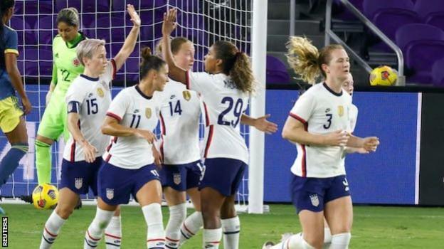 Megan Rapinoe celebrates a goal with team-mates