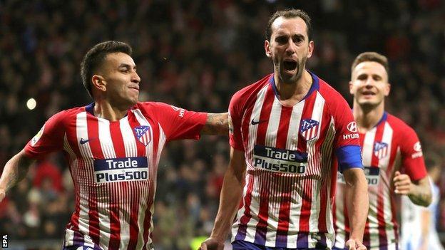 Diego Godin celebrates