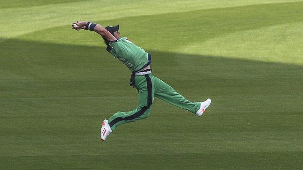 Ireland's Mark Adair at full stretch to take a superb catch to dismiss opener Javed Ahmadi