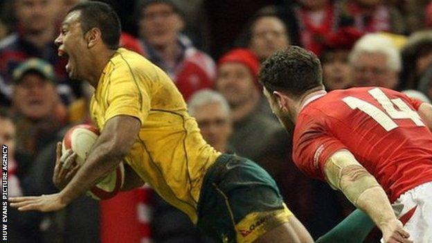 Fly-half Kurtley Beale dives over for a try with the final move of the game to give Australia a 14-12 win over Wales in 2012