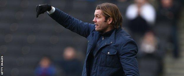 Robbie Neilson oversees an MK Dons fixture