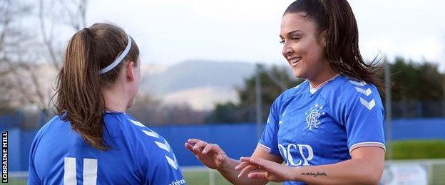 Megan Bell (left) of Rangers congratulated by a team-mate