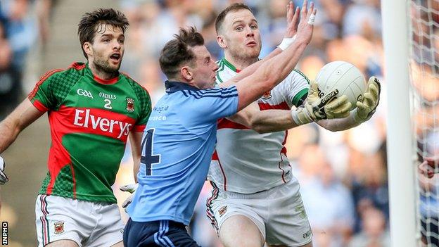 Philly McMahon beats Mayo goalkeeper Rob Hennelly to score Dublin's second goal in Croke Park