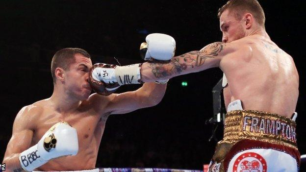Scott Quigg (left) takes a punch from Carl Frampton