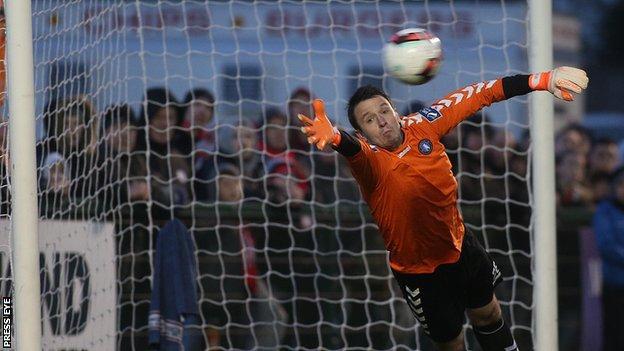 Limerick keeper Brendan Clarke fails to stop Barry McNamee's free-kick hitting the net
