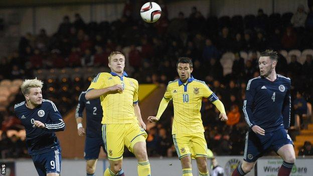 Jason Cummings heads a goal for Scotland Under-21s against Ukraine